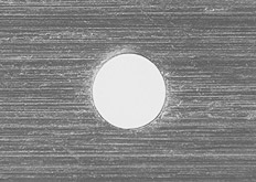 Microphotograph of a 0.2 mm pinhole.